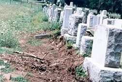 The cemetery and the crew was unaware that the area being excavated contained old, poorly documented gravesites...